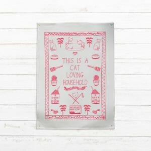 This is a cat loving household - tea towel