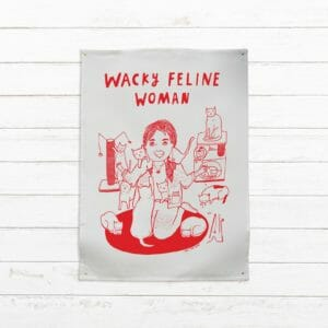 wacky feline woman tea towel